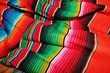 Leinwanddruck Bild - Mexican poncho serape background fiesta mexico cinco de mayo striped pattern background scrunched wrinkled stock photo photograph image picture