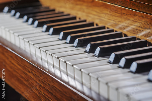 Fototapeta Close up of piano keyboard with limited depth of field