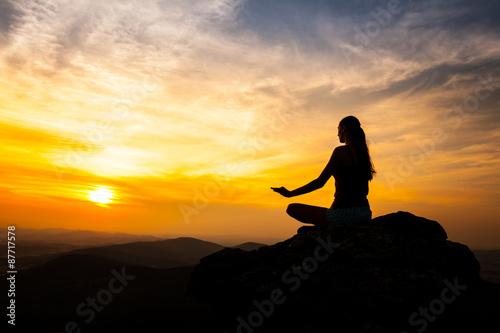 Yoga practicioner in sunset Canvas Print