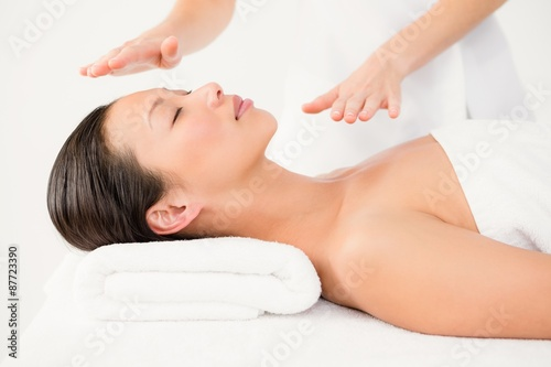 Photo  Woman receiving alternative therapy