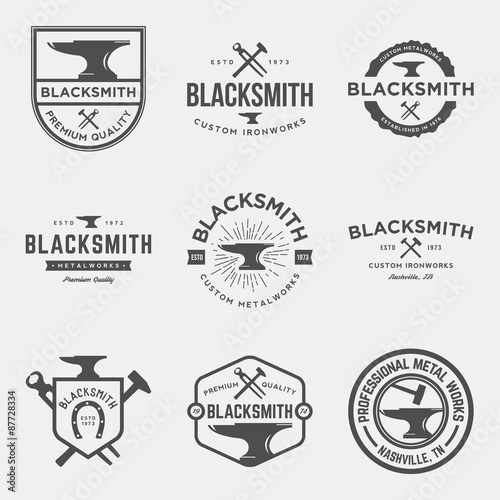 Fotomural vector set of blacksmith vintage logos, emblems and design elements
