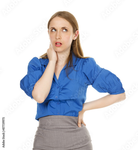 Fotografering  An aggravated businesswoman rolling her eyes with one hand on her hip and one on her face