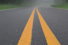Double Yellow Lines On Road In The Fog