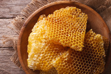 Golden Honeycombs On A Wooden Plate. Horizontal Top View Closeup