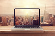 canvas print picture - Laptop computer over New York city skyline. Retro filter effect