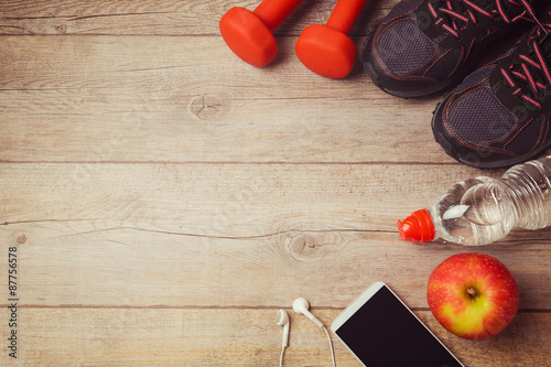 Fotografie, Obraz  Fitness background with bottle of water, dumbbells and athletic shoes