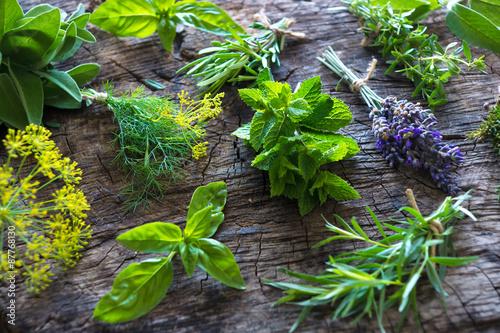 Foto  Fresh herbs on wooden background