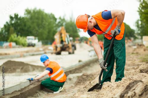 Obraz na plátně Manual labourer working