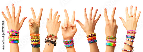 Fotografía  Female hands with bracelets isolated on white
