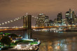 Panoramic View on Manhattan Skyline and Brooklyn Bridge at Night