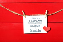 There Is Always A Reason To Smile Message With Clothespins