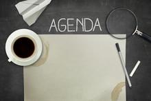 Agenda Concept On Black Blackboard With Empty Paper Sheet