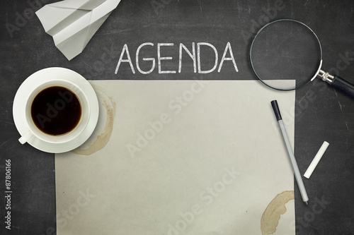 Agenda concept on black blackboard with empty paper sheet Canvas Print