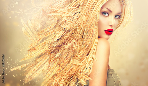 Beauty fashion model girl with gold long wheat ears hair