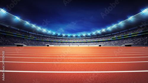 Fotografía  athletics stadium with track at panorama night view
