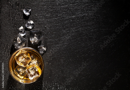 Canvas Prints Bar Glass of whiskey with ice on black stone table