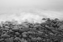 Evening Tide On The Beach With Stones In A Long Exposure