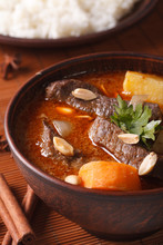 Thai Massaman Curry With Beef And Peanuts Macro. Vertical
