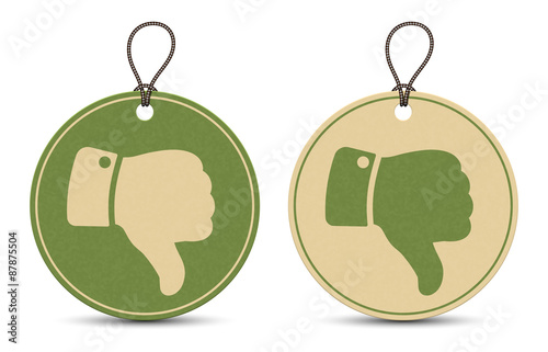 Fotografía  Two paper thumb down tags isolated on white background
