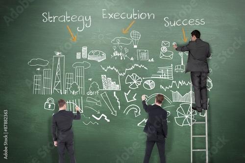 Fotografía  Composite image of business team writing