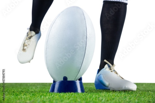Rugby player doing a drop kick - Buy this stock photo and