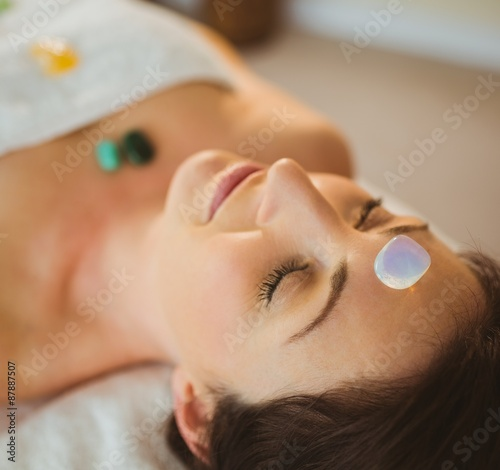 Fotografie, Obraz  Young woman at crystal healing session