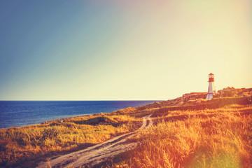 Fototapeta Morze lighthouse near a sea in autumn time