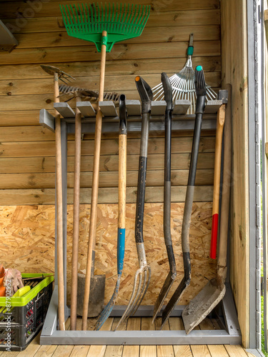 Foto op Canvas Paarden Rack with garden tools