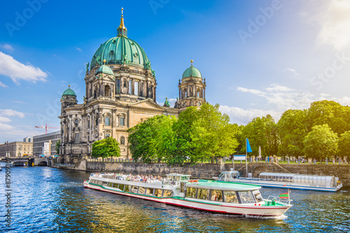 Garden Poster Berlin Famous Berlin Cathedral at Museumsinsel with excursion boat on Spree river at sunset, Berlin, Germany