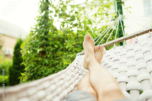 Poster  Man in a hammock on a summer day, close up photo