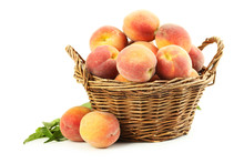 Fresh Peach Fruit In Basket Isolated On A White