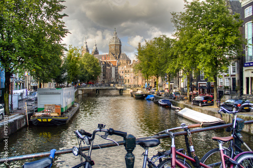 Photo  A bridge with bicycles in Amsterdam, Netherlands