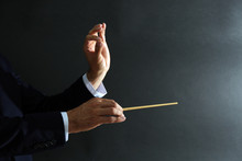 Music Conductor Hands With Bat...