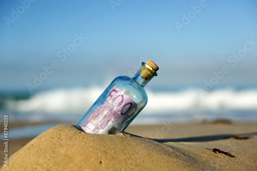 500 euro note in a bottle found on the beach, southern Europe Canvas Print