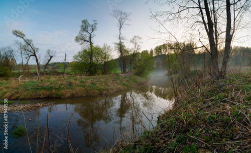 spring landscape misty morning on the river