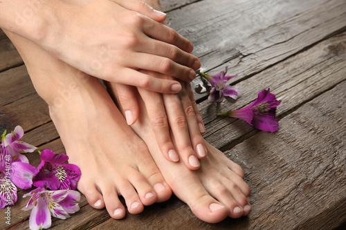 Poster Pedicure Female feet at spa pedicure procedure