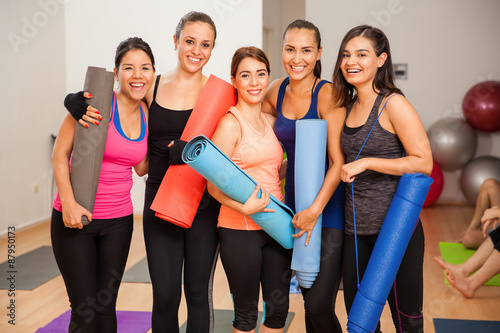 Group of girls in a yoga studio Poster