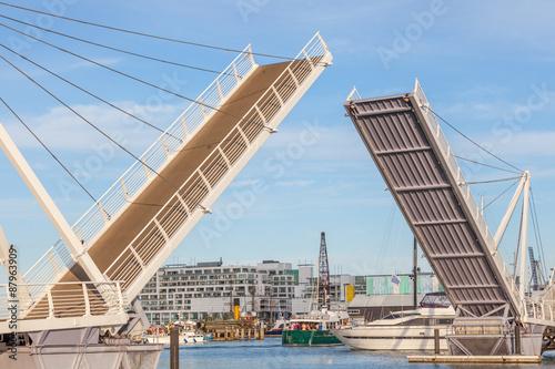 Photo Opened drawbridge allow shipping through at the harbor.