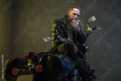 Photo Adult Man Smoking Cigarette on his Motorcycle