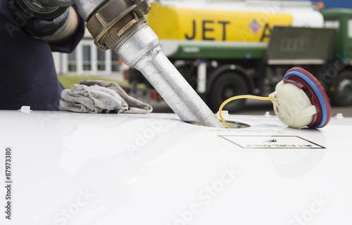 Fuel nozzle filling up aircraft