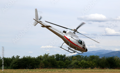 Tuinposter Helicopter helicopter takes off from the airport to bring tourists over the