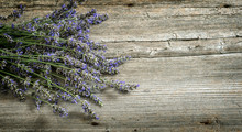 Lavender Flowers On Wooden Background. Vintage Style Toned