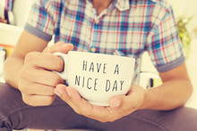 Young Man With A Cup With The Text Have A Nice Day