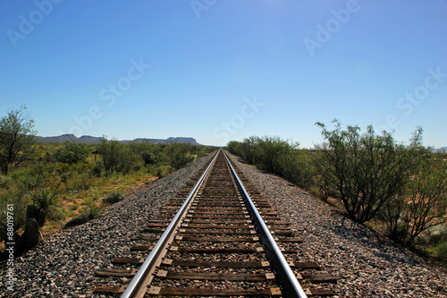 Fotobehang Spoorlijn Railroad Tracks Go on for Miles in West Texas