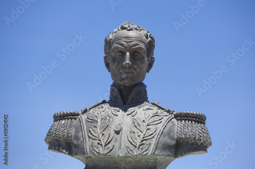 Simon bolivar sculpture against blue sky Wallpaper Mural