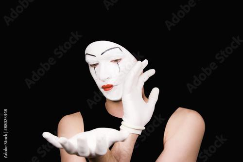 Valokuva  Portrait of  mime in white gloves