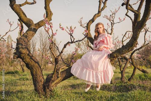 Valokuva  Fairytale woman on the tree branch