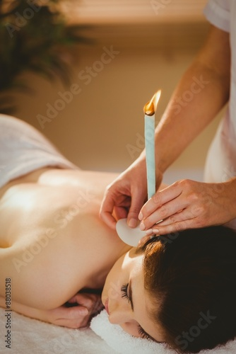Photo  Young woman getting ear candling treatment