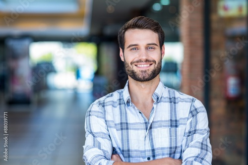 Fotografie, Obraz  Portrait of man with arms crossed looking at camera