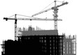 black and gray two cranes above unfinished buildings